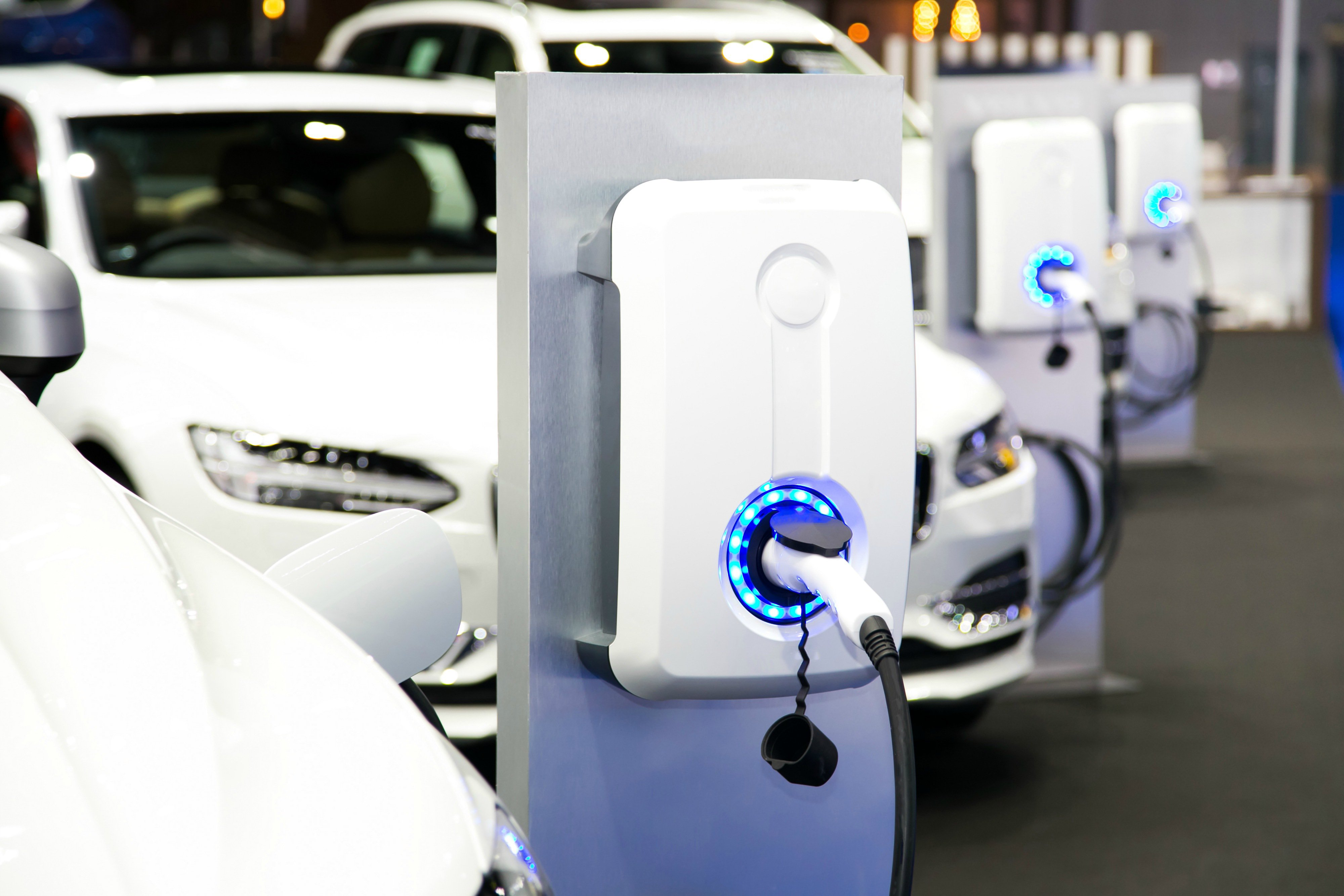 GRIDSERVE Electric car charging ports with electric cars plugged in