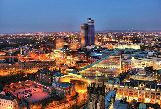 Manchester cityscape at night.