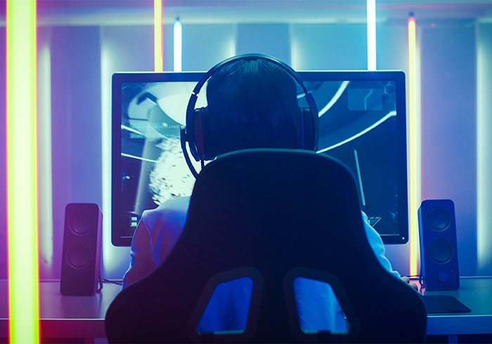Image of a person playing a video game.